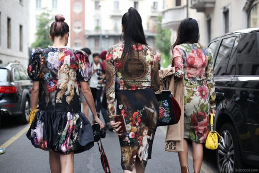 Street fashion never looked better as these woman are wearing elaborate colored dresses with prints of flower designs.