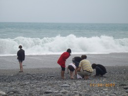 Pebble beach on the east coast of Taiwan, with the Pacific Ocean pounding down on it.