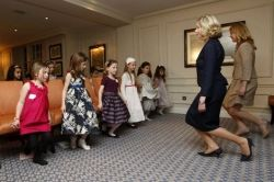 Young girls learning the curtsey