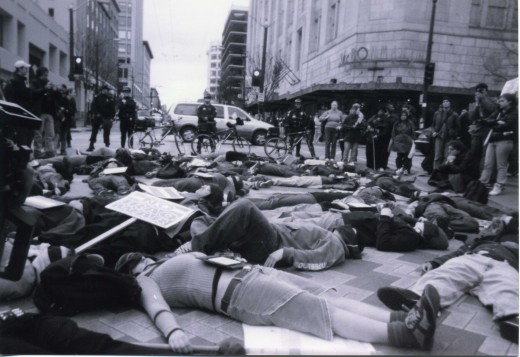 "This is downtown Seattle.  The ""bodies"" on the ground are high school students.  They wanted to make a point that collateral damage often means dead bodies."