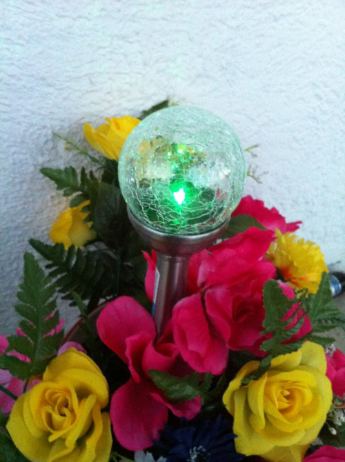 Nestle outdoor solar lights into your flowers for a creative effect!