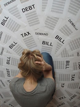 Debt can quickly becoming overwhelming! (Photo by, Steve Woods)