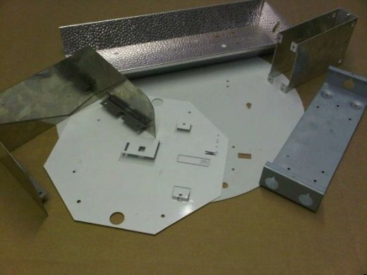 A range of sheet metal components used in the lighting industry.