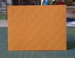 Folded Light Orange cardstock embossed