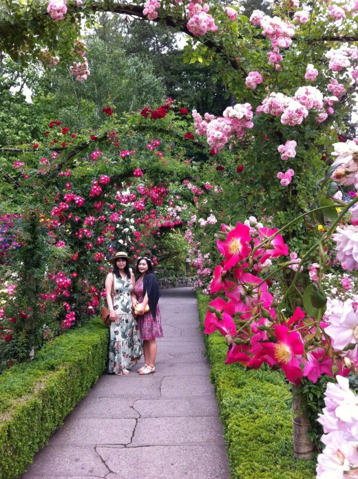 Two Women enjoying flowers and a garden path
