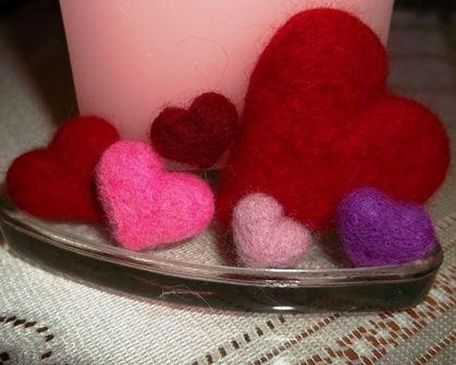 Hand full of felted hearts