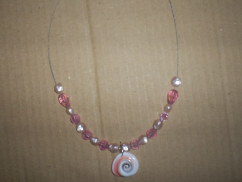 Continue adding beads to the necklace.