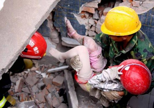 Rescue workers rejoiced when they found children still clinging to life.