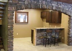 basement bar with stone finish