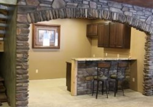 basement bar with stone finish