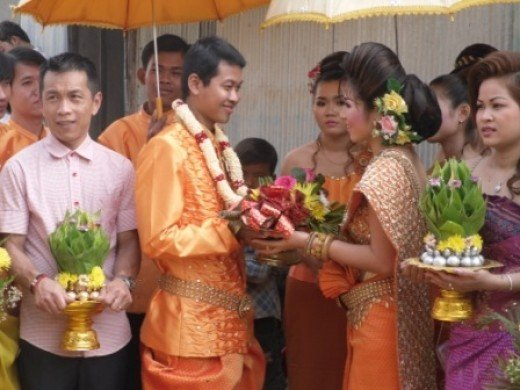 The Khmer bride placing a garland on the groom