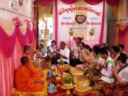 Asking for the monks blessing at a Khmer wedding