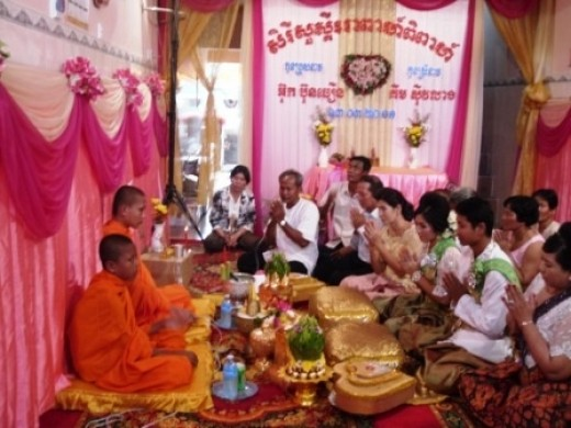 Praying with the monks at a Khmer wedding