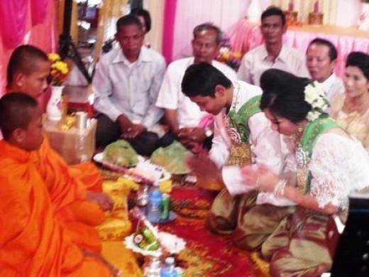 Khmer Bride and groom offering to the monks incense, tea, sugar, milk and money