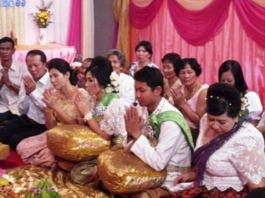 Khmer Bride and Groom Receiving the wedding blessing from the monks