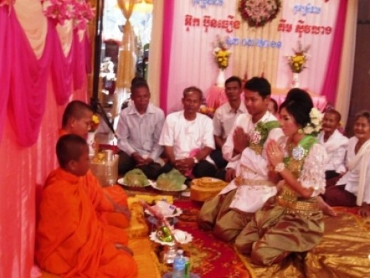 Monks blessing the bride and groom at a Cambodian wedding