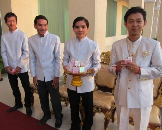 Groom Greeting Guests at Khmer Wedding