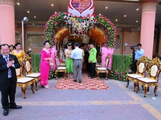 Parents welcoming guest to the Khmer wedding reception