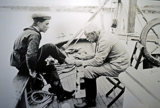 Grenfell doctoring a sailor's foot.  I photographed photo that was on the wall at the Grenfell Museum.