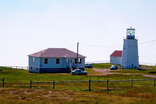 The historic building behind the tower was once home to the lighthouse keeper but is now open to the public as an Interpretive Centre.