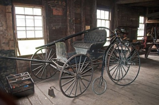 A carriage was in the blacksmith shop for repair.