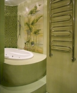 This bathroom, done in a soothing Spa Green, provides a welcome respite from the stress of daily life.