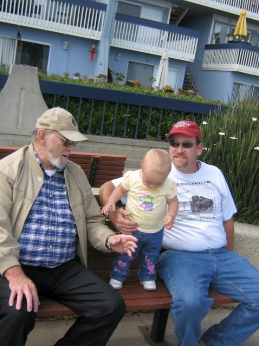 Father and Grandpa (with our first beloved granddaughter - Marissa)