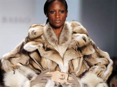 She should know better! She is wearing second hand clothes, the fur belongs to animals who are killed for this fur coat!