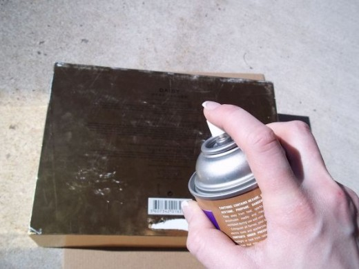 Use the spray adhesive to adhere the paper.