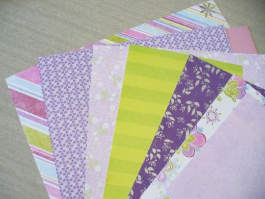 For Ruthie's binder, I picked out a selection of pretty purple papers.  I probably won't use all of these, but it's nice to have a selection to choose from.