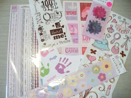 For the girls' binders I gathered a pile of cute, girly embellishments.  I probably won't use all of these, but it's nice to have a selection to choose from.