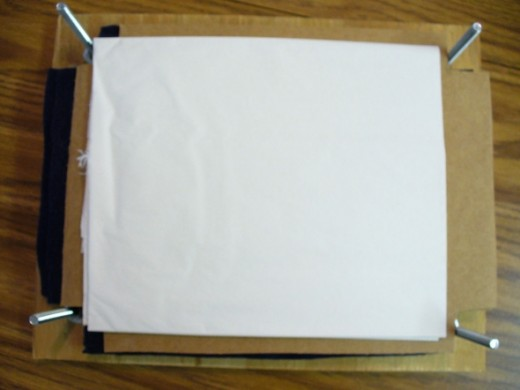 Finally, white, undyed tissue paper was cut to fit the press.