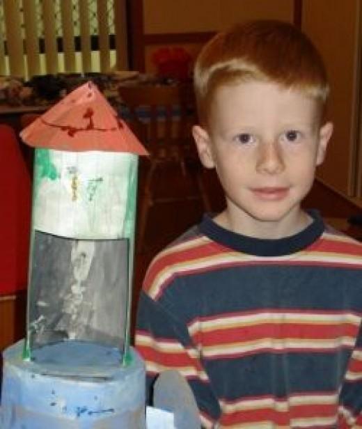 Riley and his rocket in preschool.