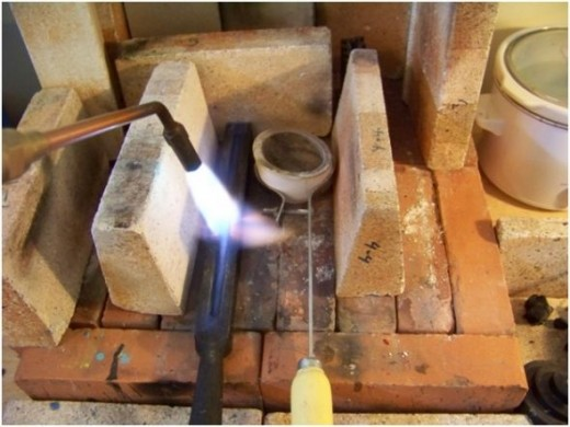preheat ingot mold, metals studio, art studio, making ingot, casting ingot