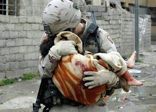 A U.S. Army soldier comforts a child fatally wounded by a car bomb blast in Mosul, 225 miles northwest of Baghdad. Where did these feeling of compassion come from... It was God who gave them to us.PHOTO BY Michael Yon for TIME Magazinemichaelyon-o