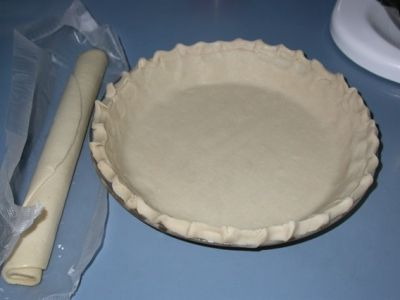 Pie crust: in its natural habitat and after I artfully crimped the edges