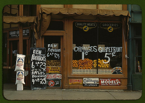 1943-- Grand Grocery Co. Lincoln, Nebraska. Oranges for a penny apiece. Squeeze your own orange juice, and you'll have no packaging trash to toss. [Library of Congress- Public Domain image.]