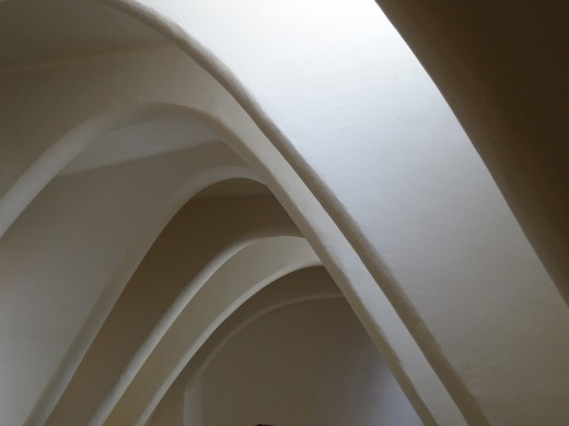 parabolic arches feature in the houses and the church