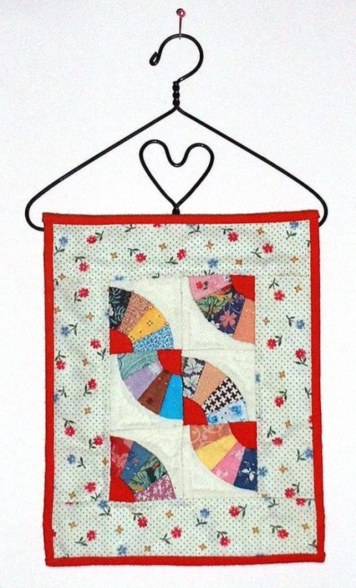 Tiny quilt on a tiny hanger
