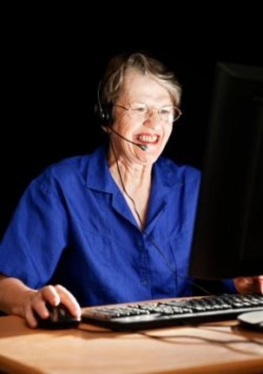 Teacher at computer with webcam