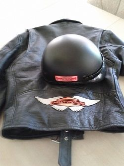 Harley jacket and motorcycle helmet