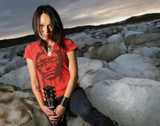 Lucie Idlout, Nunavut's gift to alternative rock, poses on the ice at Sylvia Grinell Territorial Park.