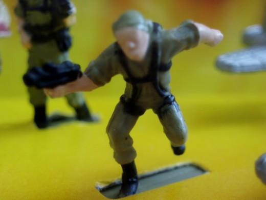 A running soldier. From 98' Micro Machines #19 World War II Allied set.