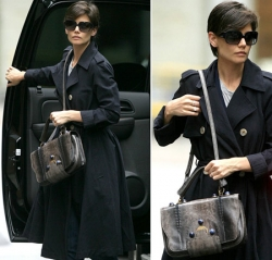 Katie Holmes with pythonskin purse