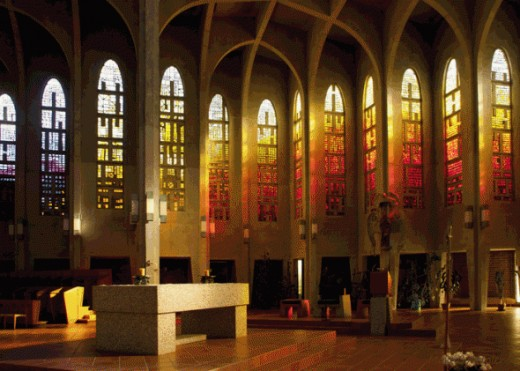The church has 64 stained-glass windows around its perimeter. These colorful windows are 22ft high and they bring in different colors as the sun hits them