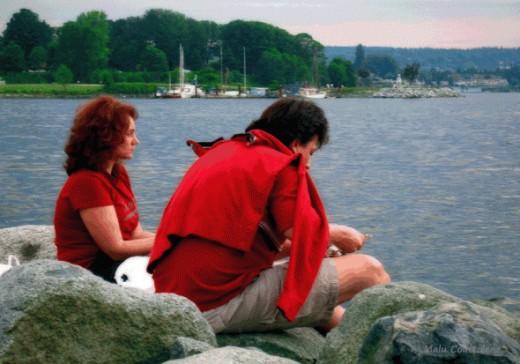 Vancouverites enjoy picnics at English Bay on sunny days