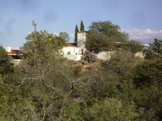 The Kannally family home situated on top of a hill overlooking the park.  The home, which is now a museum, along with the surrounding land and buildings was donated by Lucile Kannally in her will to the State of Arizona to be used as a park.