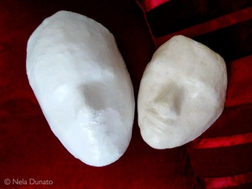 Handmade plaster and papier mache mask forms
