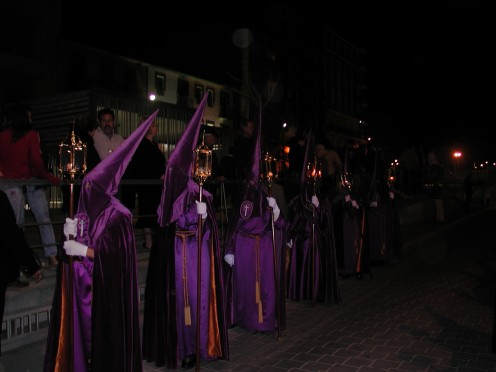 Penitents with the KKK style robes including the pointed hats