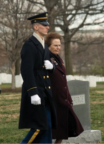 United States Army Arlington Lady being escorted to the grave of a service member